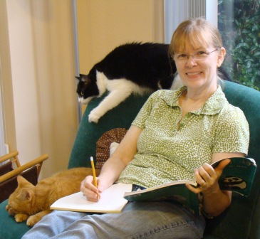 Marianne Dyson at home with cats.