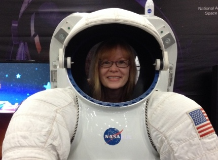 Marianne tests out a space suit at Comicpalooza, May, 2015